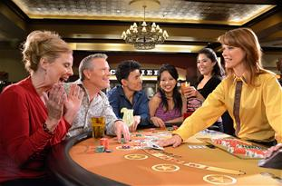 Group of people playing a casino game