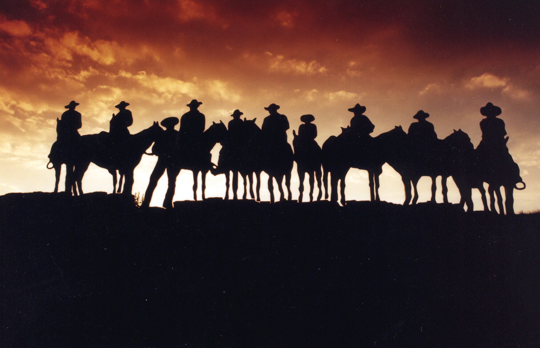 Cowboys with their Horses at Sunset in Dodge City, Kansas